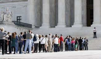 Visitors line up to enter the Supreme Court in Washington, Tuesday, Oct. 14, 2014, as the justices begin the second week of the new term. The landscape has changed very quickly for gay marriage in the U.S. Last week, the Supreme Court declined to hear appeals from several states seeking to retain their bans on same-sex marriage. The Oct. 6 move effectively legalized gay marriage in about 30 states and triggered a flurry of rulings and confusion in lower courts across the nation. (AP Photo/J. Scott Applewhite)