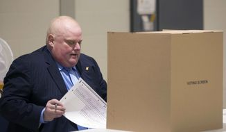 Toronto Mayor Rob Ford sits to down to cast his ballot in advance voting for the Toronto Municipal Election at a polling station in the Etobicoke area of Toronto, on Tuesday, Oct. 14, 2014. Ford, who is between chemotherapy treatments for a rare and aggressive form of cancer, says he wanted to support his brother Doug Ford's bid for the mayor's job. (AP Photo/The Canadian Press, Chris Young)