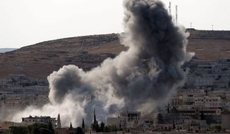 conflagration: Thick smoke rises following an airstrike by the U.S.-led coalition in Kobani, Syria, as fighting continued between Syrian Kurds and militants of the Islamic State group. Kobani, also known as Ayn Arab, has been under assault since mid-September. Story, A9 (Associated Press)