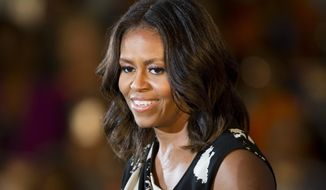 First lady Michelle Obama campaigns for Pennsylvania Democratic gubernatorial candidate Tom Wolf Wednesday, Oct. 15, 2014, at the Dorothy Emanuel Recreation Center in Philadelphia. (AP Photo/Matt Rourke) ** FILE **
