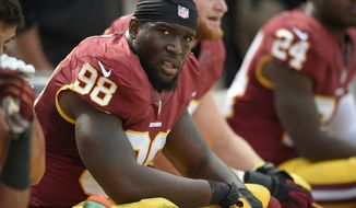 Washington Redskins outside linebacker Brian Orakpo (98) looks on from the bench during the second half of an NFL football game against the Jacksonville Jaguars, Sunday, Sept. 14, 2014, in Landover, Md. The Redskins won 41-10. (AP Photo/Nick Wass)