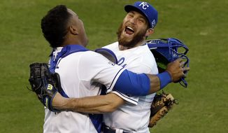 Kansas City Royals relief pitcher Greg Holland and catcher Salvador Perez celebrate after defeating against the Baltimore Orioles 2-1 in Game 4 of the American League baseball championship series Wednesday, Oct. 15, 2014, in Kansas City, Mo. The Royals advance to the World Series. (AP Photo/Chris O'Meara)