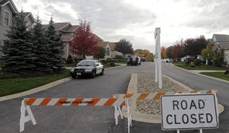 Tallmadge police cordon off a home in Tallmadge, Ohio, Wednesday, Oct. 15, 2014, where Amber Joy Vinson stayed over the weekend before flying home to Dallas. Vinson, a nurse who helped care for Thomas Eric Duncan, has also been diagnosed with the Ebola virus. (AP Photo/Mark Duncan)