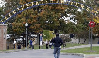 Students walk the campus at Kent State University in Kent, Ohio Wednesday, Oct. 15, 2014. (AP Photo/Mark Duncan) ** FILE **