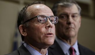 Dr. Dan Varga, chief clinical officer at Texas Health Presbyterian Hospital, speaks as Dallas Mayor Mike Rawlings looks on at right during a news conference, Wednesday, Oct. 15, 2014, in Dallas. A second health care worker has tested positive for Ebola. (AP Photo/LM Otero)
