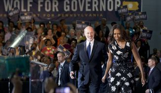 First lady Michelle Obama campaigns for Pennsylvania Democratic gubernatorial candidate Tom Wolf Wednesday, Oct. 15, 2014, at the Dorothy Emanuel Recreation Center in Philadelphia. (AP Photo/Matt Rourke)