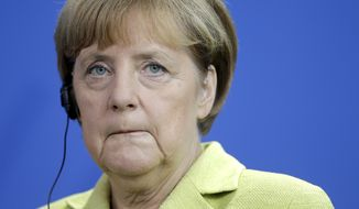 German Chancellor Angela Merkel attends a joint press conference as part of a meeting with Prime Minister of Vietnam Nguyen Tan Dung, at the chancellery in Berlin, Germany, Wednesday, Oct. 15, 2014. (AP Photo/Michael Sohn)