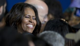 First lady Michelle Obama meets with audience members as she campaigns for Pennsylvania Democratic gubernatorial candidate Tom Wolf, center right, Wednesday, Oct. 15, 2014, at the Dorothy Emanuel Recreation Center in Philadelphia. (AP Photo/Matt Rourke)