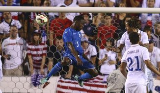 Honduras' Maynor Figueroa (3) scores the tying goal as U.S. Nation Team's Jermaine Jones (13) and Timmy Chandler (21) watch during the second half of  an international friendly game in Boca Raton, Fla., Tuesday, Oct. 14, 2014. The game ended in 1-1 tie. (AP Photo/J Pat Carter)