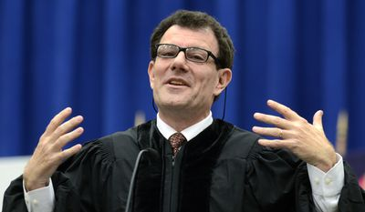 Nicholas Kristof (above, at Syracuse University's 2013 commencement) was taking hits from his liberal media compatriots this week. (Kevin Rivoli/AP Images for Syracuse University)