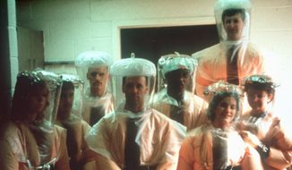 Outbreak: A 1989 Veterinary Medicine Division team at the U.S. Army Medical Research Institute of Infectious Diseases (USAMRIID) found Ebola could be spread airborne in primates. (Associated Press)