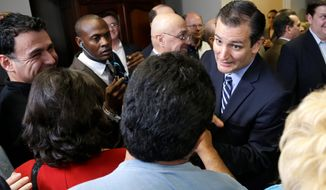 "Sen. Ted Cruz (right), Texas Republican, joined a group of local pastors in decrying the city's move to subpoena sermons and other communications related to a court battle over the Houston Equal Rights Ordinance (HERO), also known as the ""bathroom bill."" (Associated Press Photographs)"