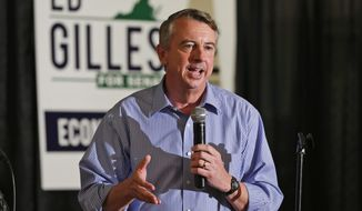 FILE - This Wednesday Oct. 15, 2014 file photo Republican U.S. Senate candidate, Ed Gillespie speaks during a rally in Ashland, Va.  Gillespie is ditching television ads in the state with less than three weeks before he faces US Sen. Mark Warner, D-Va., on Election Day. (AP Photo/Steve Helber)