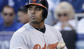 Baltimore Orioles' Nelson Cruz reacts after striking out during the fourth inning of Game 4 of the American League baseball championship series against the Kansas City Royals Wednesday, Oct. 15, 2014, in Kansas City, Mo. (AP Photo/Matt Slocum )