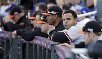 Baltimore Orioles' Nelson Cruz watches during the sixth inning of Game 4 of the American League baseball championship series against the Kansas City Royals Wednesday, Oct. 15, 2014, in Kansas City, Mo. (AP Photo/Matt Slocum )