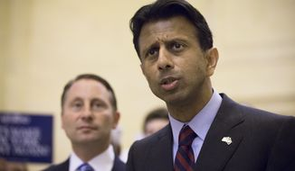 Louisiana Gov. Bobby Jindal, R-La., speaks alongside Rob Astorino, New York republican gubernatorial candidate, during a news conference to discuss New York Gov. Andrew Coumo's response to questions about the states preparations against the Ebola virus at Grand Central Station, Thursday, Oct. 16, 2014, in New York. (AP Photo/John Minchillo)