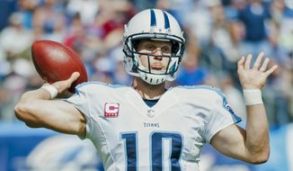Tennessee Titans quarterback Jake Locker (10) throws a pass during the Titans' 29-28 loss to the Cleveland Browns on Sunday, Oct. 5, 2014, at LP Field in Nashville, Tenn. (AP Photo/The Daily News, Austin Anthony)