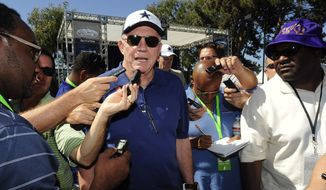 """File - In this July 23, 2014, file photo, Dallas Cowboys owner Jerry Jones talks with the media at the conclusion of the """"State of the team"""" news conference during Dallas Cowboy's training camp, in Oxnard, Calif. An Oklahoma woman accuses Jones in a lawsuit of paying her for at least four years to keep her from reporting an alleged sexual assault. A hearing on whether the lawsuit should be dismissed is scheduled for Friday, Sept. 26 in Dallas. (AP Photo/Gus Ruelas, File)"""