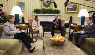 President Barack Obama speaks to the media about the government's Ebola response, in the Oval Office of the White House Thursday, Oct. 16, 2014, in Washington. From left are Lisa Monaco, Assistant to the President for Homeland Security and Counterterrorism, Sylvia Burwell, Secretary of Health and Human Services, the President, and Dr. Thomas Frieden, Director of the Centers for Disease Control and Prevention. (AP Photo/Jacquelyn Martin)