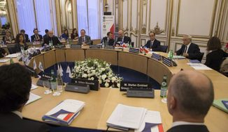 French President Francois Hollande, second from right, attends a meeting with International economic organizations at the OECD in Paris, Friday Oct. 17, 2014. The heads of major international economic organizations are to discuss the global economy following turmoil in financial markets this week and worries about another recession in Europe. (AP Photo/Philippe Wojazer/Pool)