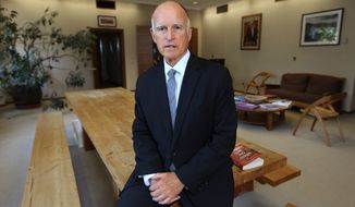 FILE - In this May 28, 2014, file photo, Gov. Jerry Brown poses in his Capitol office in Sacramento, Calif. Incumbent Brown faces Republican Neel Kashkari, a former U.S. Treasury official who has never held elective office, in the November election. Brown, 76, is on the verge of doing what no one else has ever done in California: get elected to a fourth term as governor. (AP Photo/Rich Pedroncelli, File)