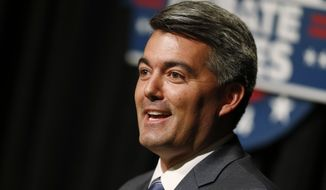 "In Colorado, analyst Stuart Rothenberg shifted the Senate contest's rating from ""pure tossup"" to ""tossup/leans Republican,"" reflecting a slew of recent polls showing Republican Rep. Cory Gardner running several points ahead of Democratic Sen. Mark Udall.  (AP Photo/David Zalubowski)"