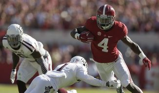 Alabama running back T.J. Yeldon (4) runs the against Texas A&M defensive back De'Vante Harris (1)during the first half of an NCAA college football game on Saturday, Oct, 18, 2014, in Tuscaloosa, Ala. (AP Photo/Brynn Anderson)
