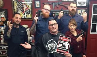 "While Pennsylvania state Rep. Marty Flynn didn't respond to a request for an interview, he appears to be embracing the role of a hero, posing for this photo at his local barbershop while holding a sign proclaiming ""Warning: Protected by Second Amendment Security,"" as the employees proudly display their firearms. The photo was quickly taken down from the Facebook page of the Loyalty Barbershop & Shave Parlor. (Facebook)"
