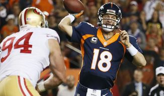Denver Broncos quarterback Peyton Manning (18) throws against the San Francisco 49ers during the first half of an NFL football game, Sunday, Oct. 19, 2014, in Denver. (AP Photo/Jack Dempsey)