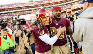 Washington Redskins cornerback David Amerson (39) hugs Washington Redskins kicker Kai Forbath (2) after he kicks a last second field goal to win the game as the Washington Redskins defeat the Tennessee Titans 19-17 at FedEx Field, Landover, Md., Sunday, October 19, 2014. (Andrew Harnik/The Washington Times)