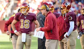 Washington Redskins quarterback Kirk Cousins (8), right, listens as Washington Redskins head coach Jay Gruden talks with Washington Redskins quarterback Colt McCoy (16) who took over as quarterback after the half as the Washington Redskins play the Tennessee Titans at FedEx Field, Landover, Md., Sunday, October 19, 2014. (Andrew Harnik/The Washington Times)