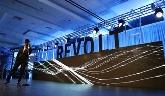Ne-Yo sings during the REVOLT Music Conference Gala Dinner at Fontainebleau Miami Beach on Oct. 17, 2014, in Miami Beach, Florida. (Photo by Marc Serota/Invision for REVOLT/AP Images)