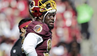 Washington Redskins outside linebacker Brian Orakpo (98) pauses on the field during the first half of an NFL football game against the Tennessee Titans, Sunday, Oct. 19, 2014, in Landover, Md. (AP Photo/Mark E. Tenally)