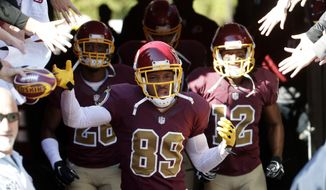 Washington Redskins wide receiver Santana Moss (89) and others, enter the field before during an NFL football game against the Tennessee Titans, Sunday, Oct. 19, 2014, in Landover, Md. (AP Photo/Pablo Martinez Monsivais)