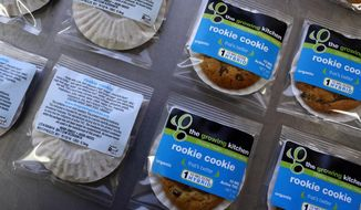 In this Sept. 26, 2014 file photo, smaller-dose pot-infused cookies, called the Rookie Cookie, sit on the packaging table at The Growing Kitchen, in Boulder. (AP Photo/Brennan Linsley,File)
