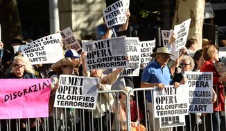 "FILE - In this Sept. 22, 2014, file photo,  protestors attend the arrivals at the Metropolitan Opera 2014-15 Season Opening  in New York to register their disapproval of the Met's decision to premiere the controversial opera ""The Death of Klinghoffer,"" later in the season. The opera, about  the hijacking of the Italian cruise ship Achille Lauro and the murder of Jewish passenger Leon Klinghoffer, is expected to attract more protesters when it opens Monday, Oct. 20, 2014. (Photo by Evan Agostini/Invision/AP, File)"