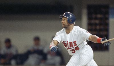 The Minnesota Twins' Kirby Puckett watches his 11th inning home run fly as the Twins beat the Atlanta Braves 4-3 in Game 6 to tie the World Series at 3-3  Oct. 26, 1991 in Minneapolis. (AP Photo/Jim Mone)