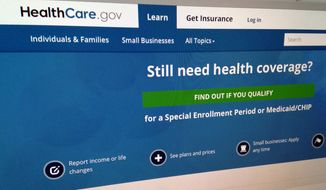 This Sept. 15, 2014, file photo shows part of the HealthCare,gov sebsite in Washington. (AP Photo/Jon Elswick, File)