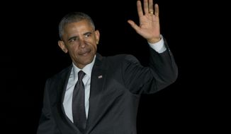 President Barack Obama waves as he walks from Marine One, across the South Lawn to the White House in Washington, Monday, Oct. 20, 2014, as he arrives from Chicago. (AP Photo/Carolyn Kaster)
