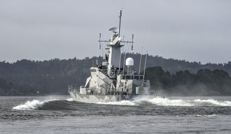 "Swedish corvette HMS Stockholm patrols Jungfrufjarden in the Stockholm archipelago, Sweden, Monday, Oct. 20, 2014. Sweden's biggest submarine hunt since the dying days of the Soviet Union has put countries around the Baltic Sea on edge, with Latvia's foreign minister calling the incident a potential ""game changer"" in the region. (AP Photo/TT News Agency, Anders Wiklund) SWEDEN OUT"