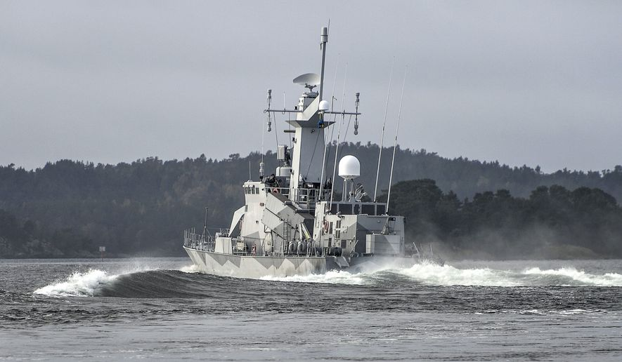 """Swedish corvette HMS Stockholm patrols Jungfrufjarden in the Stockholm archipelago, Sweden, Monday, Oct. 20, 2014. Sweden's biggest submarine hunt since the dying days of the Soviet Union has put countries around the Baltic Sea on edge, with Latvia's foreign minister calling the incident a potential """"game changer"""" in the region. (AP Photo/TT News Agency, Anders Wiklund) SWEDEN OUT"""