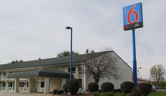 This Motel 6 in Hammond, Ind., is where the body of a woman was found. Police said Sunday, Oct. 19, 2014, that a 43-year-old man confessed to killing a woman whose body was found in the Motel 6 and told investigators where the bodies of three other women could be found in abandoned homes in Gary. The bodies of seven women have now been found in northwestern Indiana, authorities said Monday. (AP Photo/The Times, John J. Watkins)