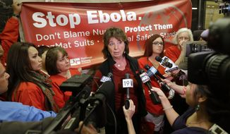 RoseAnn DeMoro, executive director of the California Nurses Association and National Nurses United  talks to reporters after meeting with Gov. Jerry Brown to discuss the Ebola crisis, Tuesday, Oct. 21, 2014, in Sacramento, Calif.   The Nurses unions, which have highly critical of the response so far, say they want California to be the national leader in enacting the highest Ebola safety standards. (AP Photo/Rich Pedroncelli) **FILE**