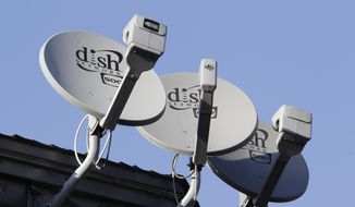 FILE - This Feb. 23, 2011 file photo shows three Dish Network satellite dishes at an apartment complex in Palo Alto, Calif. (AP Photo/Paul Sakuma, File)