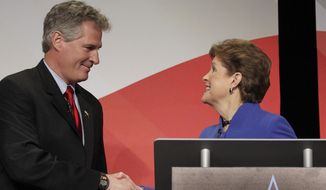 U.S. Sen. Jeanne Shaheen, right, greets Republican challenger Scott Brown before a live televised debate hosted by New England Cable News, the Concord Monitor, and the University of New Hampshire at the Capitol Center for the Arts, Tuesday Oct. 21, 2014 in Concord, N.H. (AP Photo/Concord Monitor, Elizabeth Frantz, Pool)