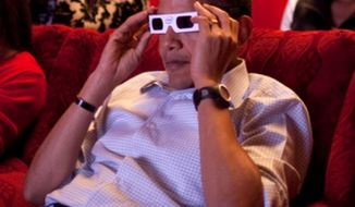 President Barack Obama and First Lady Michelle Obama wear 3-D glasses while watching a TV commercial during Super Bowl 43. White House photo.