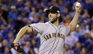 San Francisco Giants pitcher Madison Bumgarner throws during the first inning of Game 1 of baseball's World Series against the Kansas City Royals Tuesday, Oct. 21, 2014, in Kansas City, Mo. (AP Photo/David J. Phillip)