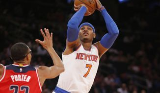 New York Knicks forward Carmelo Anthony (7) shoots with Washington Wizards forward Otto Porter Jr. (22) defending in the first half of an NBA basketball game at Madison Square Garden in New York, Wednesday, Oct. 22, 2014. (AP Photo/Kathy Willens)