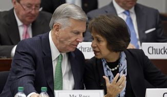 University of North Carolina President Tom Ross, left, and  Chancellor Carol Folt talk during a special joint meeting of the University of North Carolina Board of Governors and the UNC-Chapel Hill Board of Trustees in Chapel Hill, N.C., Wednesday, Oct. 22, 2014. The board gathered to discuss the results of an independent investigation of past academic irregularities. (AP Photo/Gerry Broome)