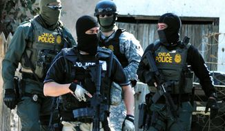 Drug Enforcement Administration Special Agents. (Associated Press) ** FILE **